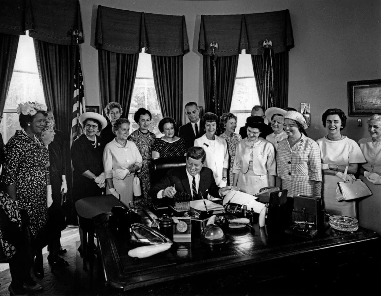 The President's Pen - American Association of University Women members with President John F. Kennedy as he signs the Equal Pay Act into law